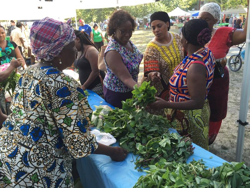 Members of AARI selling native African vegetables at a farmer's market in Providence. Source: Rhode Island Public Radio, 2015