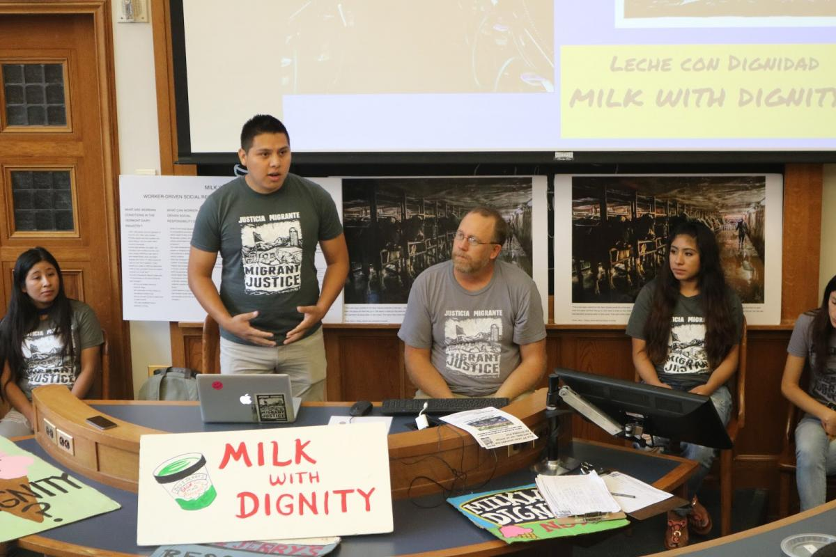 Migrant Justice workers speaking at tour event