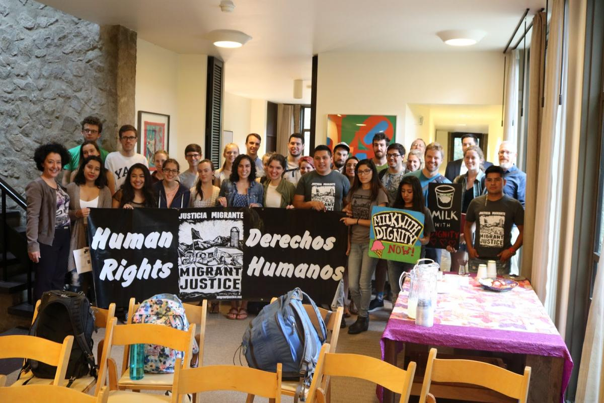 students and Migrant Justice workers with signs at tour event