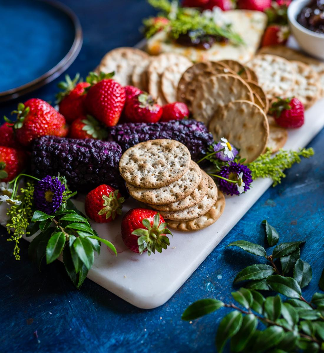 strawberries and crackers platter with flowers